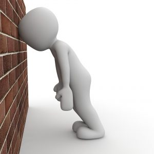 Man against wall